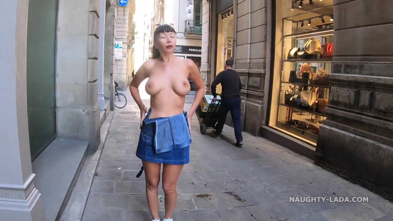 Naughty russian MILF Lada shows her boobs on public
